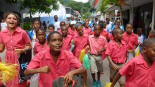 Children running excitedly down the streets during the celebrations in Mauritius.