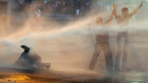 Supporters of opposition leader Leopoldo Lopez are hit by police's water canon during a protest against Nicolas Maduro's government in Caracas