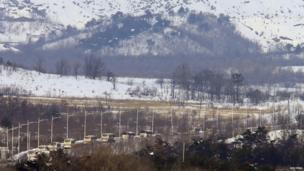 South Korean buses transporting participants of the family reunion cross the border line as they leaves for Mount Kumgang resort in North Korea at Goseong, about 200 km (124 miles) northeast of Seoul on 20 February 2014