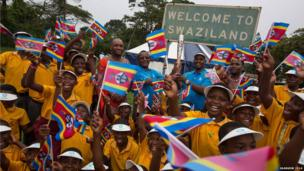 The Queen's Baton arrives at Lomahasha border crossing point, Swaziland - the first time the baton reached a new country on foot.
