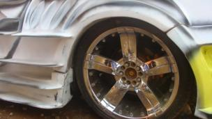 The wheel of a car being remodelled at Godfrey Namunye's garage in Kampala, Uganda