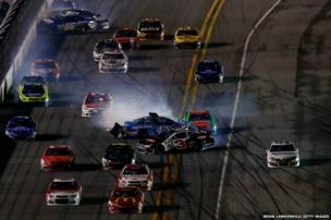 Austin Dillon, driver of the #3 DOW Chevrolet, and Aric Almirola, driver of the #43 Smithfield Ford, spin in a pack of cars during the Nascar Sprint Cup Series Daytona 500