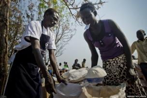 18-year-old Nyandeng Matiop collect's the family's monthly food ration from the World Food Programme.