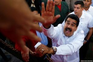 Venezuela's President Nicolas Maduro greets supporters