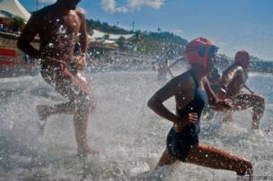Lifeguards enter the water in La Libertad, El Salvador