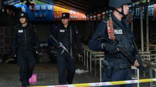 Chinese police stand guard at the scene of an attack at the main train station in Kunming, Yunnan province on 2 March 2014