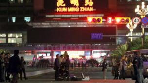 Chinese police investigators inspect the scene of an attack outside the railway station in Kunming, southwest China's Yunnan province, on 2 March 2014