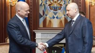 Ukraine's acting President Olexander Turchynov (right) meets British Foreign Secretary William Hague in Kiev