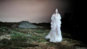 A model wearing a dress by Alexander McQueen