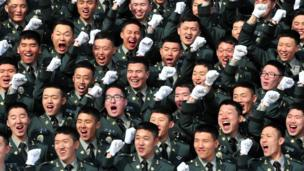New military recruits cheer during a commissioning ceremony in South Korea