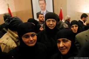 A group of Greek Orthodox nuns arrive back in Damascus