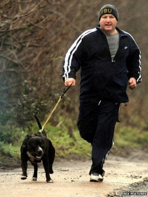 Bob Crow, leader of the RMT Union out for a morning jog with his dog Castro, 2010