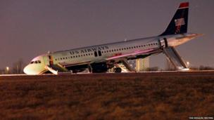 US Airways plane with a collapsed nose is seen at Philadelphia International Airport