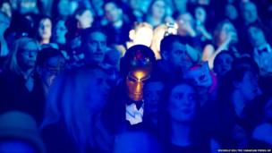 Concert goers wear masks at the Arcade Fire at the Air Canada Centre in Toronto