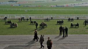Racegoers begin to arrive as the fog lingers in Cheltenham