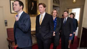 British Chancellor of the Exchequer George Osborne (left) prepares to lead his Treasury team out of 11 Downing Street in London