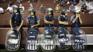 Riot police stand guard during a Copa Libertadores football match