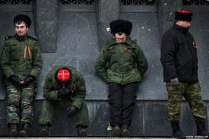 Cossacks guard the regional parliament building during the Crimean referendum in Simferopol, Ukraine