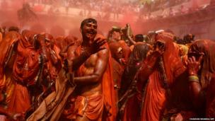 Indian revellers take part in the game of Huranga at The Dauji Temple in Mathura, south of New Delhi