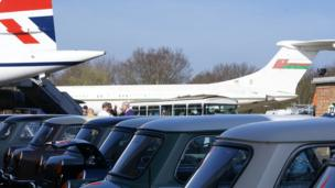 Cars in the shadow of display aircraft at Brooklands Mini Day 2013