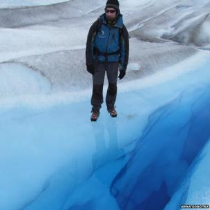 Man standing on glacier