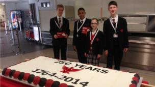 Bedford Modern School pupils with the cake made by school canteen staff.