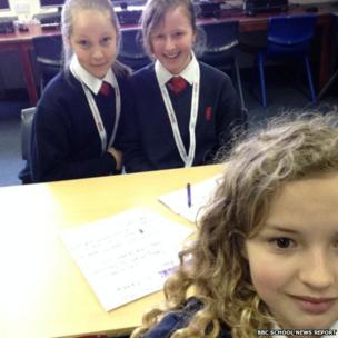 Holly, Alex and Gracie pose for a selfie in the class room