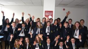 Students celebrate a successful day at Mountbatten school in Hampshire.