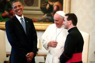 US President Barack Obama laughs during his meeting with Pope Francis, as Monsignor Mark Miles looks on, at the Vatican