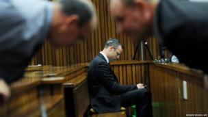 Paralympian Oscar Pistorius is seen in the courtroom after his murder trial was postponed