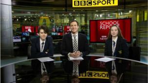 BBC Sport presenter John Watson with Niamh and Henry from Poynton High School.