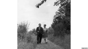 Dylan Marlais Thomas (1914 - 1953), Welsh poet, short-story writer and playwright, walking with his wife Caitlin, 10th August 1946.
