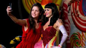 Fan Tansy Ratcliffe-James poses with the newly unveiled wax figure of Katy Perry