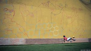 A member of Kenya's squad taking part in the Street Child World Cup in Rio de Janeiro, Brazil, practises against a wall