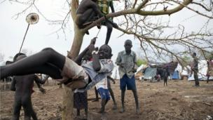 South Sudanese children play in a makeshift swing at a refugee camp in Ethiopia on 2 April 2014