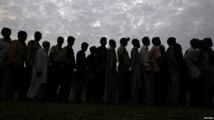 People line up to cast their vote outside a polling station in Tinsukia district in the north-eastern Indian state of Assam.