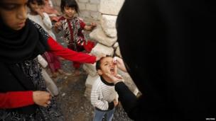 Yemeni boy receiving polio vaccine