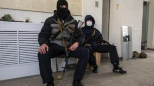 Suspected pro-Russian gunmen inside the offices of the state security service in Luhansk, in eastern Ukraine.