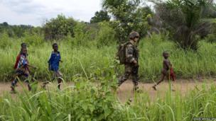 A French soldier of the 13th Alpine Hunters Battalion patrols near the northwestern city of Boda in the Central African Republic