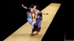 Brazilian designer Alessa Migani makes her way down the runway