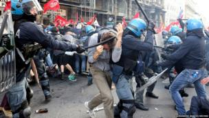 Demonstrators clash with police during a protest against austerity measures in downtown Rome.