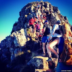 People climb mountain in Cape Town