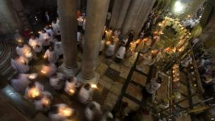 Christian clergymen in the Church of the Holy Sepulchre in Jerusalem on 20 April 2014