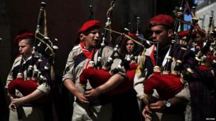 Israeli Arab Christian boy scouts play bagpipes during an Easter Monday parade in Jaffa.