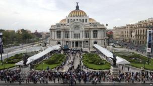 People wait outside the Fine Arts Palace in Mexico City, April 21, 2014