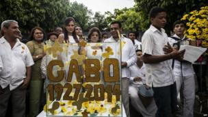 Local authorities and other people participate in a symbolic funeral in Aracataca, Colombia, April 21, 2014.