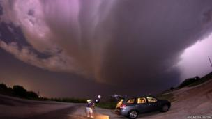 A thunderstorm passes over storm chaser Brad Mack in Graham, Texas