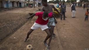 Boy playing street football, Bangui, CAR - Wednesday 23 April 2014