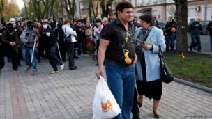 Masked pro-Russia protesters pelt supporters of Ukrainian presidential candidate Yulia Tymoshenko with eggs outside a regional government building in Donetsk, in eastern Ukraine.