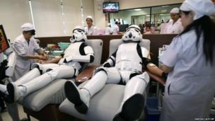 Two Star Wars fans gave blood to the Red Cross in Thailand dressed as stormtroopers as part of a charity project celebrating the annual Star Wars Day - 28 April 2014.
